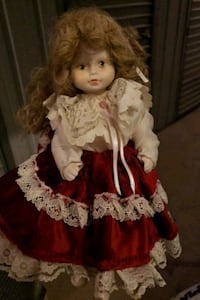 Porcelain doll in red and white dress 404 mi