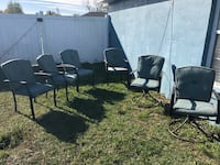six black metal armchairs with pads