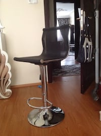 Black and stainless steel rolling chair