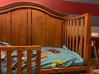 Toddler convertible bed and cabinet. Both are made out of solid wood. Comes with rails for crib and toddler bed. Fredericksburg