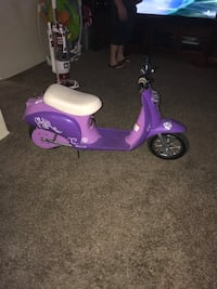 Purple and white electric scooter with charging cord Bakersfield, 93304