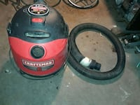two red and black canister vacuum cleaners Fresno, 93703