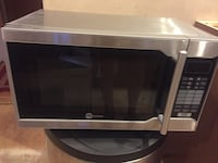 stainless steel and black microwave oven New York, 11203