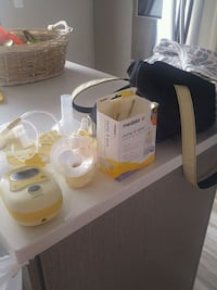 Handsfree medela breast pump with bag and cover up Laval