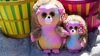 two brown-pink-and-blue Ty Beanie Babies hedgehogs toys