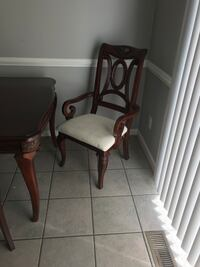 two brown wooden framed white padded armchairs Gainesville, 20155