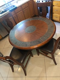 Wooden/ceramic dining set with 4 seats leather cushions West Hempstead, 11552