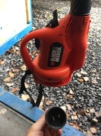 red and black Black & Decker power tool