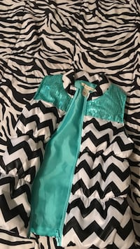 white and black chevron zip up gilet jacket with blue teal on it and sequins