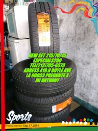 black vehicle tire set with text overlay Los Angeles, 90033