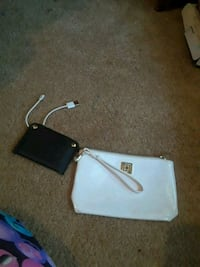 two white and black leather wristlet wallets