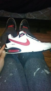 unpaired white and red Nike Airmax sneaker