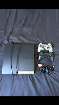 Black sony ps3 slim console with controllers Oakland, 94606