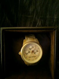 round gold chronograph watch with white leather st New York, 10033