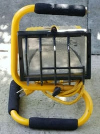 Portable work light with handle in yellow and blac