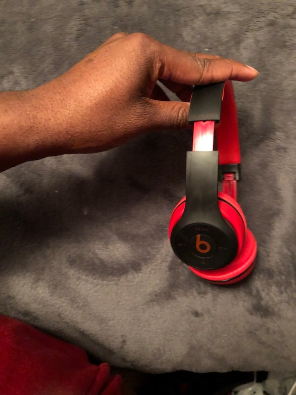 Black and red beats by dr. dre wireless headphone