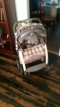 baby's brown and white folding stroller Warner Robins, 31088