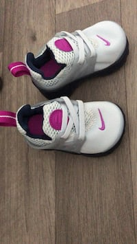 Pair of white-and-black nike running shoes London, N16