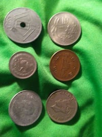 five silver round coins and one copper coins