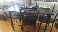 Black dining room table with chsirs Markham