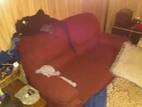 Red dual reclining couch 20 dollars  Winston-Salem, 27107