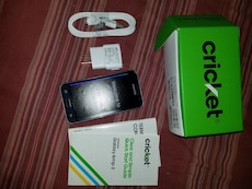 black Samsung Galaxy Amp2 with accessories