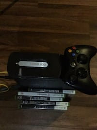 black Xbox 360 console with controller and game cases Suitland, 20746