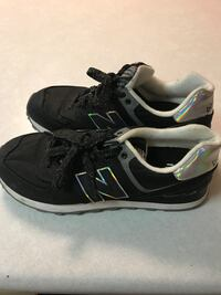 pair of black-and-white New Balance low-top sneakers