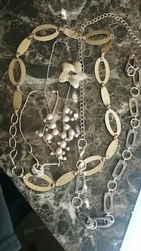 silver-colored necklaces