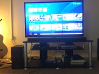 black flat screen TV with black wooden TV stand Regina, S4S 6A7
