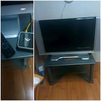 gray flat screen TV with brown wooden TV stand Fort Pierce, 34950