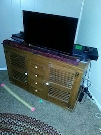 brown wooden entertainment center El Paso, 79925