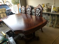 Rectangular brown wooden table with four chairs dining set Las Vegas, 89117