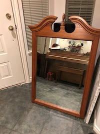 rectangular mirror with brown wooden frame Coquitlam, V3E 3C4