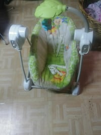 baby's white and green portable swing