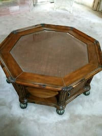 brown wooden framed glass top coffee table 467 km