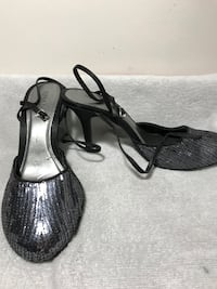 pair of black leather open-toe sandals Calgary, T2L