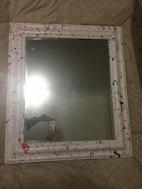square white and pink wooden framed mirror