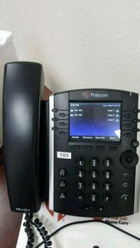 black and gray Panasonic IP phone