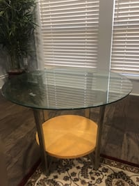 Glass round table 21 inches high and 28 inches diameter