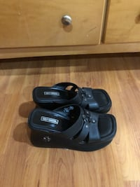 pair of black leather sandals null