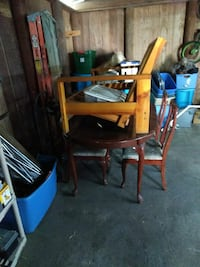 brown wooden armchair and dining set