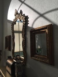 """All 3 ornate gold mirrors for $250. Will separate. Pair of rectangular mirrors $150. Round 36"""" mirror $150. All 3, meaning 1 round and 2 rectangular, for $250 firm. LARGE ornate mirror is not for sale. The 1 round and 2 rectangular mirrors are for sale. Boca Raton, 33496"""