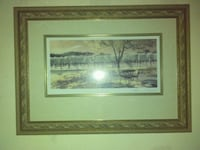 land filled with tress painting with brown frame