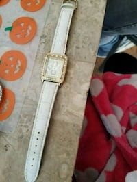 white and brown leather belt 335 mi