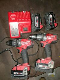 red and black Milwaukee cordless power drill 550 km