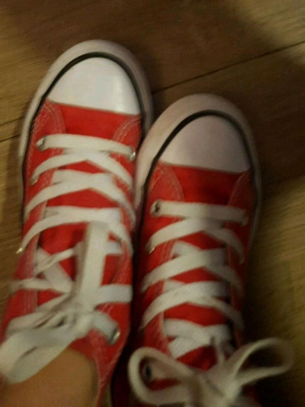 pair of white-and-red sneakers