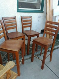 two brown wooden armless chairs Manteca, 95337