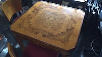 Unique game table and four chairs. 5 different tops and roulette wheel in the bottom!! Virginia Beach, 23452