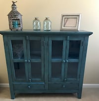 Distressed 4 door cabinet. Beautiful aqua color. BRAND NEW. $399 from Bob's Furniture. Save $99  Plainfield, 60586